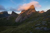 Kråkhammartind mountain peak illuminated at sunrise, Moskenesøy, Lofoten Islands, Norway