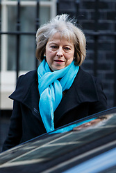 © Licensed to London News Pictures. 24/02/2015. LONDON, UK. Home Secretary Theresa May attending to a cabinet meeting in Downing Street on Tuesday, 24 February 2015. Photo credit: Tolga Akmen/LNP