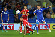 Cardiff City Anthony Pilkington (r) shoots wide of the goal while being challenged by Blackburn's Shane Duffy (on floor). EFL Skybet championship match, Cardiff city v Blackburn Rovers at the Cardiff city stadium in Cardiff, South Wales on Wednesday 17th August 2016.<br /> pic by Carl Robertson, Andrew Orchard sports photography.