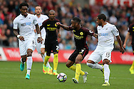 Raheem Sterling of Manchester city goes past Swansea's Wayne Routledge ® and Leroy Fer (l). Premier league match, Swansea city v Manchester city at the Liberty Stadium in Swansea, South Wales on Saturday 24th September 2016.<br /> pic by Andrew Orchard, Andrew Orchard sports photography.