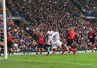 Stelios Giannakopolous (Bolton) (7) scores goal (no.2) with Michael Duberry stranded. Leeds United v Bolton Wanderers. 22/11/2003. Credit : Colorsport/Andrew Cowie.
