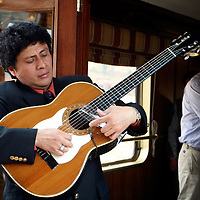 South America, Peru. Musicians entertain guests in the observation car of the Hiram Bingham luxury train to Machu Picchu.