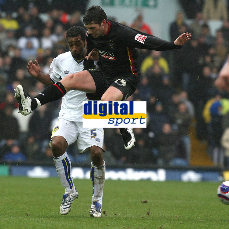 Photo: Paul Greenwood/Sportsbeat Images.<br />Leeds United v Huddersfield Town. Coca Cola League 1. 08/12/2007.<br />Leeds United Rui Marques, (L) is challenged by Huddersfield's Phil Jevons