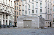 "The Judenplatz Holocaust Memorial also known as the Nameless Library stands in Judenplatz in the first district of Vienna, Austria. It is the central memorial for the Austrian victims of the Holocaust and was designed by the British artist Rachel Whiteread. Unveiled on 25 October 2000, Inscriptions below the doors read ""In commemoration of more than 65,000 Austrian Jews.who were killed by the Nazis between 1938 and 1945."""