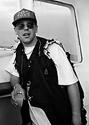 Adam Clayton photographed on the Rainbow Warrior at a U2 Greenpeace protest at the Sellafield Nuclear Plant in June 1992.
