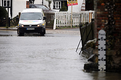 © Licensed to London News Pictures. 5/02/2014<br /> A van turning round because of high flood water from the river Darent in Eynsford,Kent<br /> Wet and windy weather conditions continue across the UK. <br /> The river Darent in Eynsford,Kent has risen to 3 feet at the Eynsford ford flooding the road and fields.<br /> Photo credit :Grant Falvey/LNP