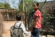 Pooja, 14, a student from the village of Pathpuri, Hoshangabad, Madhya Pradesh, India, taking part to the children's journal, a project launched by Dalit Sangh, an NGO which has been working for the uplift of scheduled castes for the past 22 years, is walking her younger brother Narendra Kumar, 9, to school. Dalit Sangh is working in collaboration with Unicef India to promote education and awareness within backward communities.