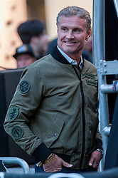 © Licensed to London News Pictures. 02/05/2016. London, UK. Ex Formula 1 driver, David Coulthard, welcomes arrivals at the finish line. Large crowds come to Regent Street to see the arrivals of supercars in the Gumball 3000 race.  Supercars race from Dublin to Bucharest, stopping at major cities en route including London. Photo credit : Stephen Chung/LNP