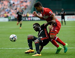 May 20, 2017 - Washington, DC, USA - 20170520 - D.C. United midfielder LLOYD SAM (8) tries to play the ball from the pitch, while also battling Chicago Fire defender BRANDON VINCENT (3) in the second half at RFK Stadium in Washington. (Credit Image: © Chuck Myers via ZUMA Wire)