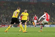 Arsenal's Alexis Sanchez scoring his sides second goal<br /> <br /> UEFA Champions League- Arsenal vs Borussia Dortmund- Emirates Stadium - England - 26th November 2014 - Picture David Klein/Sportimage