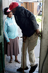 Cape Town-180815-Thozi Mciki (50) one of the people that suffers from the rarest, most disabling genetic conditions known to medicine,Fibrodysplasia ossificans progressiva (FOP) causes bone to form in muscles, tendons, ligaments and other connective tissues. Bridges of extra bone develop across joints, progressively restricting movement and forming a second skeleton that imprisons the body in bone. There are no other known examples in medicine of one normal organ system turning into another.In the picture Thozi navigates his way through the narrow doorway at his Gugulethu home. Pictures:Brendan Magaar/African News Agency (ANA)