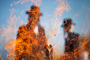 Ultra Orthodox Jewish father and son are burning chametz (leavened food) before the Jewish holiday of Passover. Netanya, 14 April 2014