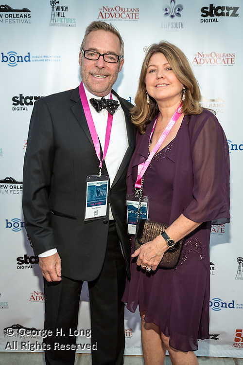 George Solomon and guest on the red carpet during opening night of the 25th Anniversary New Orleans Film Festival; Opening night film is 'Black and White' directed by Mike Binder