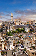View of the ancient Sassi of Matera area exterior, Basilicata, Italy. <br /> <br /> The area of Matera has been occupied since the Palaeolithic (10th millennium BC) making it one of the oldest continually inhabited settlements in the world. <br /> <br /> The town of Matera was founded by the Roman Lucius Caecilius Metellus in 251 BC and remained a Roman town until  was conquered by the Lombards In AD 664 becoming part of the Duchy of Benevento.  Matera was subject to the power struggles of southern Italy coming under the rule of the Byzantine Roman, the Germans and finally Matera was ruled by the Normans from 1043 until the Aragonese took possession in the 15th century. <br /> <br /> At the ancient heart of Matera are cave dwellings known as Sassi. As the fortunes of Matera failed the sassy became slum dwelling and the appalling living conditions became be the disgrace of Italy. From the 1970's families were forcibly removed from the Sassi and rehoused in the new town of Matera. Today tourism has regenerated Matera and the sassi have been modernised and are lived in again making them probably the longest inhabited houses in the world dating back 9000 years. .<br /> <br /> Visit our ROMAN ART & HISTORIC SITES PHOTO COLLECTIONS for more photos to download or buy as wall art prints https://funkystock.photoshelter.com/gallery-collection/The-Romans-Art-Artefacts-Antiquities-Historic-Sites-Pictures-Images/C0000r2uLJJo9_s0<br /> .<br /> <br /> Visit our MEDIEVAL PHOTO COLLECTIONS for more   photos  to download or buy as prints https://funkystock.photoshelter.com/gallery-collection/Medieval-Middle-Ages-Historic-Places-Arcaeological-Sites-Pictures-Images-of/C0000B5ZA54_WD0s