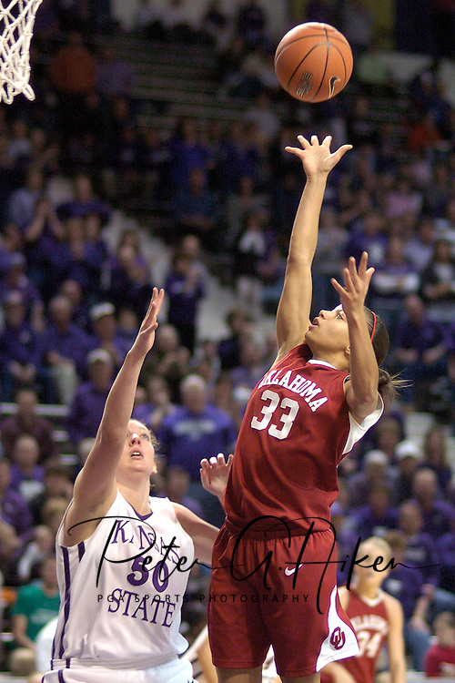 Oklahoma guard Britney Brown (33) drives the lane and scores over Kansas State's Jessica McFarland (50), during the first half at Bramlage Coliseum in Manhattan, Kansas, February 21, 2006.  The Wildcats lead the 9th ranked Sooners at halftime 39-36.
