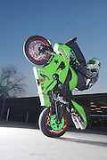 Eric Hoenshell on his House of Kawasaki sponsored ZX-6 stunt bike in front of House of Kawasaki showroom