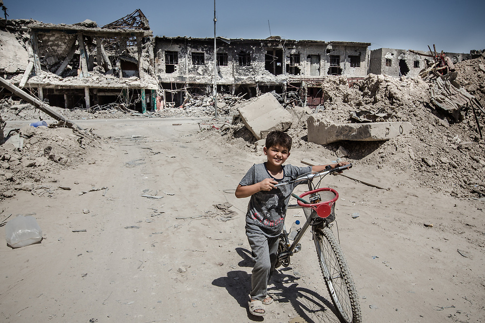 A boy walks through the rubble in the old city after Mosul was liberated.