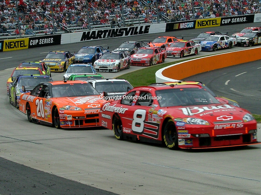 Dale Earnhardt, Jr. leading Tony Stewart out of turn 2 at Martinsville Speedway during the Goody's Cool Orange 500