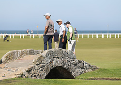 Former US president Barack Obama on the Swilcan Bridge while playing a round of golf at the Old Course in St Andrews, Fife, during his visit to Scotland.