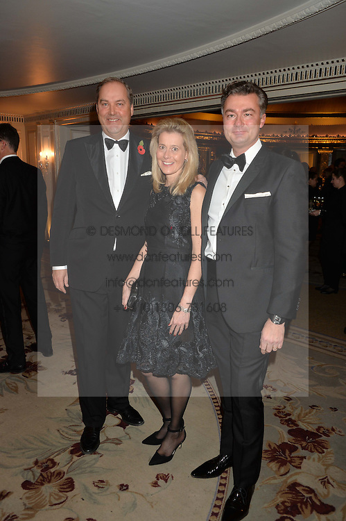 Left to right, the HON.HARRY HERBERT and LAURENT FENIOU MD of Cartier UK and his wife CARINE FENIOU at the 26th Cartier Racing Awards held at The Dorchester, Park Lane, London on 8th November 2016.