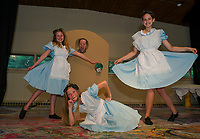 "SKYT's (Streetcar Kids Youth Theater) production of Alice in Wonderland will feature three ""Alice's"" in the cast played by Ella Denney, Isabella Cottrell and Zoe Lehneman shown here with ""Doorknob"" Savannah Shepard during dress rehearsal Monday evening.  (Karen Bobotas/for the Laconia Daily Sun)"