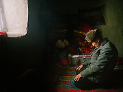 Prayer time at Haji Osman's house..Campment of Tshar Tash (Haji Osman's camp), in the Wakhjir valley, at the source of the Oxus..Winter expedition through the Wakhan Corridor and into the Afghan Pamir mountains, to document the life of the Afghan Kyrgyz tribe. January/February 2008. Afghanistan