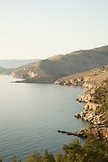High angle view of rocky coastline and tranquil blue Aegean Sea, Elinda, Chios, Greece