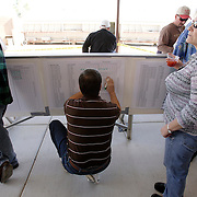 LAS VEGAS, NEVADA, November 12, 2007: Contestants from around the world gathered in Las Vegas, Nevada on November 12, 2007 to race their pigeons in the Las Vegas Classic. A man places odds on the posted betting sheets for the pigeon race.