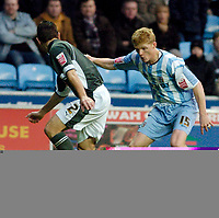 Photo: Leigh Quinnell.<br /> Coventry City v Plymouth Argyle. Coca Cola Championship.<br /> 03/12/2005. Coventrys Claus Jorgensen looks for a way past Plymouths Anthony Barness.