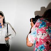 A model poses for photographers before the start of the Altuzarra Spring Summer 2017 Show in Manhattan, New York on September 8, 2016. John Taggart for The New York Times