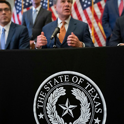 Texas Gov. Greg Abbott talks to the press after signing two bills strengthening the Texas power grid and infrastructure that were emergency items on his legislative agenda. The bills were in response to February's winter storm that nearly knocked out the Texas power grid.