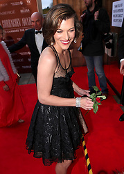 © under license to London News Pictures. 30/03/11. Milla Jovovich has a 'wardrobe malfunction' at Gorby80 Event - 80th Birthday of Gorbachev. Photo credit should read Anton Phatianov/LNP