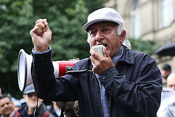 © Licensed to London News Pictures. 02/07/2016. Leeds, UK. A speaker addresses the crowd at a pro-cornyn demonstration in Leeds. Hundreds of people braved the rain in Leeds city centre, West Yorkshire, to support Labour leader Jeremy Corbyn. Corbyn, who was only elected nine months ago with an overwhelming majority, faced a vote of no confidence this week from his MPs. It is now likely that the Labour Party will see another leadership election. Photo credit : Ian Hinchliffe/LNP