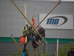 © Licensed to London News Pictures. 22/05/2021. London, UK. Members of the environmental group Animal Rebellion block McDonald's distribution centre in in Hampstead Industrial Estate in north London. Photo credit: Marcin Nowak/LNP