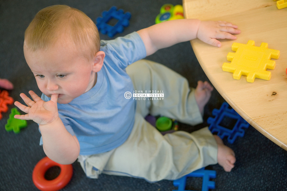 Baby at Nursery School; sucking his thumb,