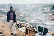 Man sells old electronical equipment in Kibera slum, Kenya
