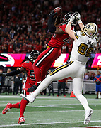 Atlanta Falcons linebacker Deion Jones makes a late game interception in front of New Orleans Saints tight end Josh Hill.