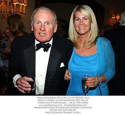 Horse racing figure MR & MRS GAY KINDERSLEY, at a dinner in London on 23rd September 2003.PNA 69