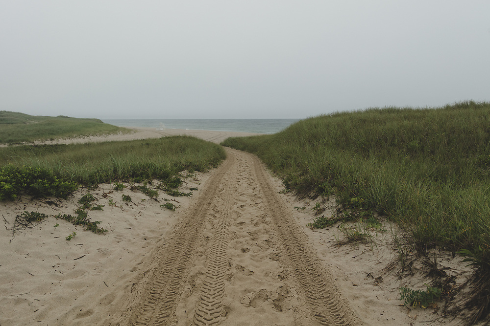 A beach road leading to the ocean at Miacomet.