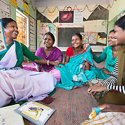 CAPTION: Sahiya Anupma Soren takes a monthly session with the 15-19-year olds. The discussion covers delaying the age of marriage, antenatal care, where the ARSH clinic is and what it does, the methods of family planning that the facility can help with, and what their respective pros and cons are. The Government requires these sessions to be conducted monthly. Sahiyas are given an incentive of ₹ 75 per session they lead. The girls are asked to come on a regular basis, as the knowledge imparted builds over time. LOCATION: Pawra Anganwadi Centre (AWC), Ghatshila (block), Purbi Singhbhum (district), Jharkhand (state), India. INDIVIDUAL(S) PHOTOGRAPHED: From left to right: Anupma Soren, Pritilata Giope, Sarshati Hansda, Maya Namata and Kajal Namata.