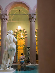 Woman climbing out of swimming pool of Palais-Thermal of Bad Wildbad, Baden-Württemberg, Germany