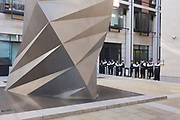 Metropolitan police officers guard the Stock Exchange premises at Paternoster Square in the City of London during world corporate greed and government austerity measures protests.