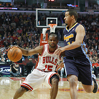 26 March 2012: Denver Nuggets point guard forward Andre Miller (24) defends on Chicago Bulls point guard John Lucas III (15) during the Denver Nuggets 108-91 victory over the Chicago Bulls at the United Center, Chicago, Illinois, USA. NOTE TO USER: User expressly acknowledges and agrees that, by downloading and or using this photograph, User is consenting to the terms and conditions of the Getty Images License Agreement. Mandatory Credit: 2012 NBAE (Photo by Chris Elise/NBAE via Getty Images)