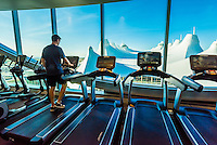 Exercise room of the Westin Denver International Airport Hotel overlooking the tent like roof of the airport's Jeppesen Terminal, Denver, Colorado USA.