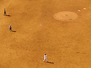 Close up of baseball field with players seen from above.