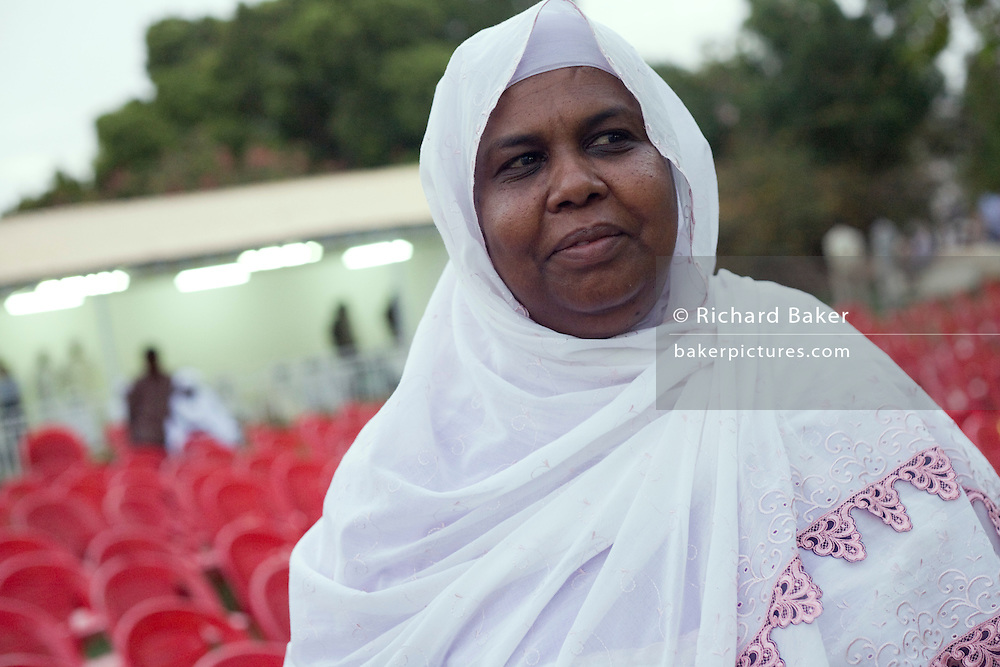 In the compound belonging to the Govenor of North Darfur, is Rajaa Hassan Khalifa, Secretary General of the Sudanese Womens' General Union during the first-ever international Conference on Womens' Challenge in Al Fasher (also spelled, Al-Fashir) where Sudanese women from remote parts of Sudan gathered to discuss peace and political issues.
