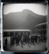 Kids playing in a school yard. Mountainous landscape in background. North Vietnam, Asia