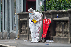 © Licensed to London News Pictures. 24/07/2021. Oxford, UK. Forensic investigators gather evidence at the scene in Oxford town centre following an altercation in which three people were stabbed. Police were called to the Park End Street at approximately 03:15BST on Saturday morning. Three men, aged 20, 22 and 26, were were taken to hospital. A 20-year-old man from Oxford has been arrested in connection with this incident. Photo credit: Peter Manning/LNP