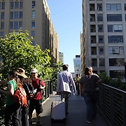 The High Line is a public park built on an historic freight rail line elevated above the streets on Manhattan's West Side built on a 1.45-mile section of the former elevated New York Central Railroad spur called the West Side Line. It is owned by the City of New York, and maintained and operated by Friends of the High Line, founded in 1999 by community residents. High Line has been redesigned and planted as an aerial greenway and is maintained as an extraordinary public space for all  to enjoy. Manhattan, New York, USA. 4th June 2013. Photo Tim Clayton