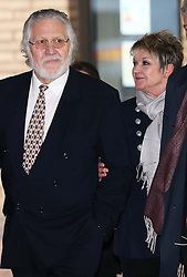 Dave Lee Travis and his wife Marianne Griffin leave Southwark Crown Court in London after he was cleared of 12 out of 14 charges, Thursday, 13th February 2014. Picture by Stephen Lock / i-Images
